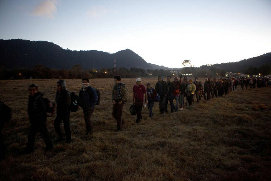 Catholic pilgrims from the Chiapas municipality of Simojovel, walk in single file to their campground, in San Cristobal de las Casas, Mexico, Sunday, Feb. 14, 2016, near the site where Pope Francis will celebrate Mass during his one-day visit. On Monday, Francis will travel to the southern indigenous state of Chiapas, Mexico's poorest and least Catholic region. (AP Photo/Eduardo Verdugo)