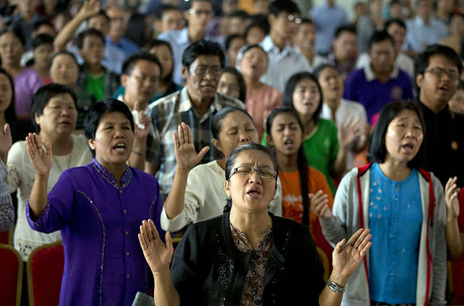 Friends and families of people living with disabilities sing gospel songs at Kayin Baptist Mission Society during a prayer session in Yangon, Myanmar, Thursday, Feb. 5, 2015. The event celebrated the 40th anniversary of the mission's affiliated school for the blind. (AP Photo/Gemunu Amarasinghe)