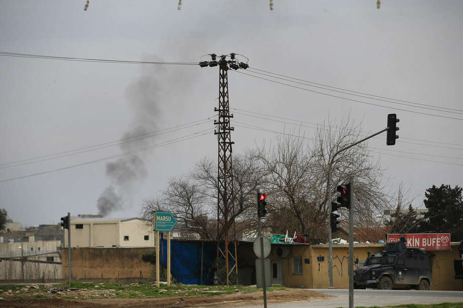 Smoke billows from a fire at the southeastern town of Nusaybin, Turkey, near the border with Syria, where Turkish security forces are battling militants linked to the outlawed Kurdistan Workers, Party or PKK, Sunday, Feb. 14, 2016, a day after Turkish media reports said a police officer was injured in a clash. The private Dogan news agency said the militants on Saturday detonated an explosive device in the town as a military vehicle was passing by, but no one injured. A second bomb was defused in a controlled explosion. (AP Photo/Lefteris Pitarakis)