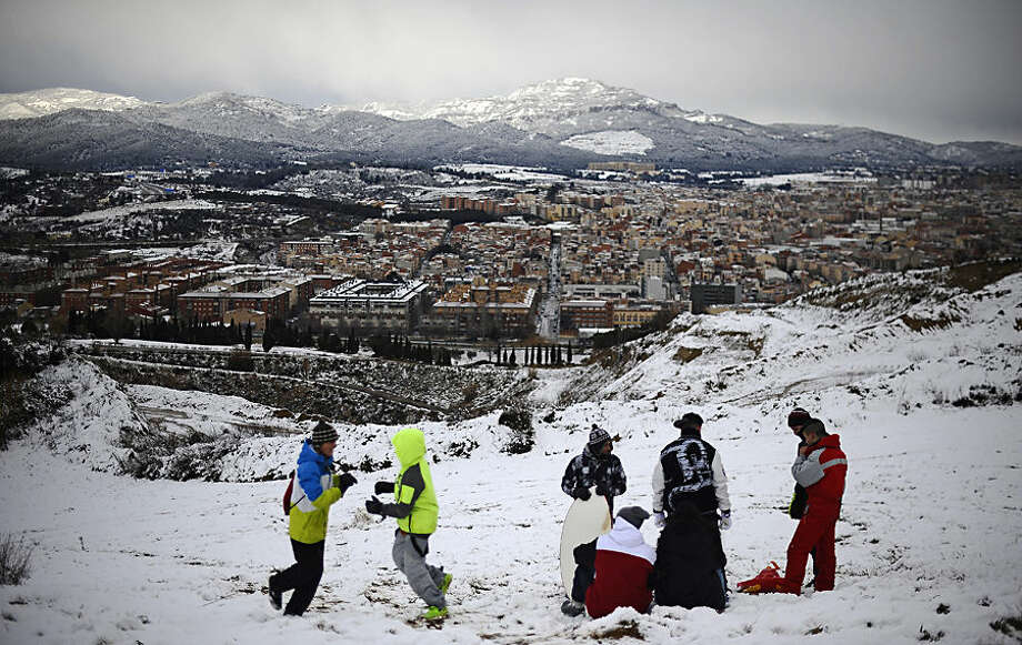 A group of people spend the day in mountain covered with snow in Terrassa, Spain, Wednesday, Feb. 4, 2015. A cold spell has reached northern Spain with temperatures plummeting far below zero. (AP Photo/Manu Fernandez)