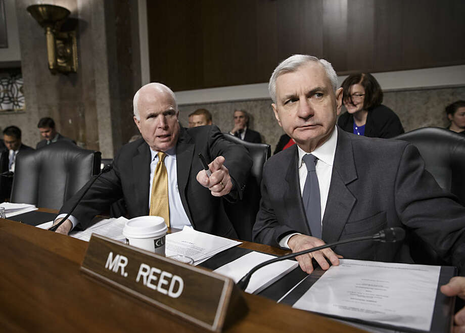 Senate Armed Services Committee Chairman Sen. John McCain, R-Ariz., left, and Sen. Jack Reed, D-R.I., the committee's ranking member, lead the confirmation hearing for Ashton Carter, President Barack Obama's choice to be defense secretary, Wednesday, Feb. 4, 2015, on Capitol Hill in Washington. Carter, who previously served as the No. 2 Pentagon official, is expected to easily win Senate confirmation but will face tough questions about Iraq and other issues. (AP Photo/J. Scott Applewhite)