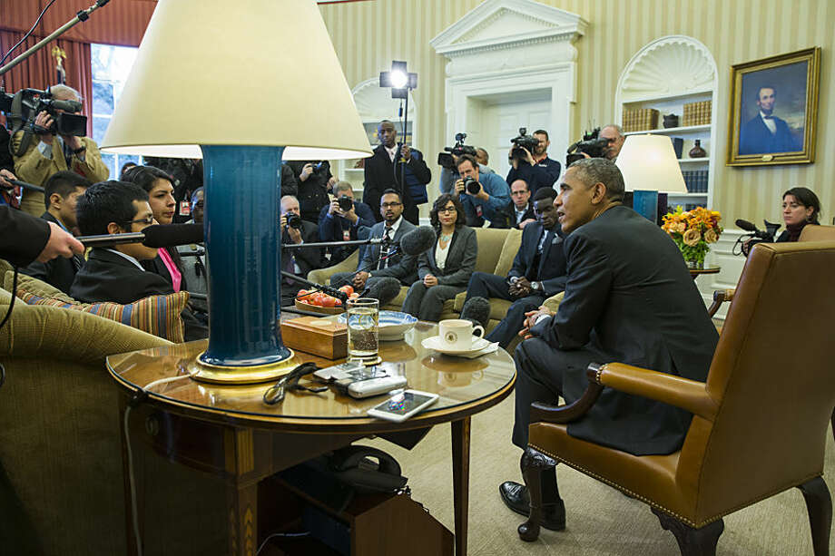 "President Barack Obama meets with a group of ""Dreamers"" in the Oval Office of the White House in Washington, Wednesday, Feb. 4, 2015. The president is accusing opponents of his immigration action of failing to think about the ""human consequences."" The president spoke during an Oval Office meeting Wednesday with six of young immigrants who would be subject to eventual deportation under a bill passed by the House. The legislation would overturn Obama's executive actions limiting deportations for millions here illegally and giving them the ability to work. (AP Photo/Evan Vucci)"