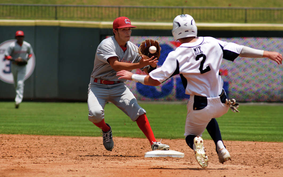 Langham Creek junior shortstop Tommy Tolve, left, makes a play against Dallas Jesuit baserunner JT Mix in the bottom of the 3rd inning of their 2016 UIL Baseball State Championships semi-final matchup at Dell Diamond in Round Rock on Friday, June 10, 2016. (Photo by Jerry Baker/Freelance)