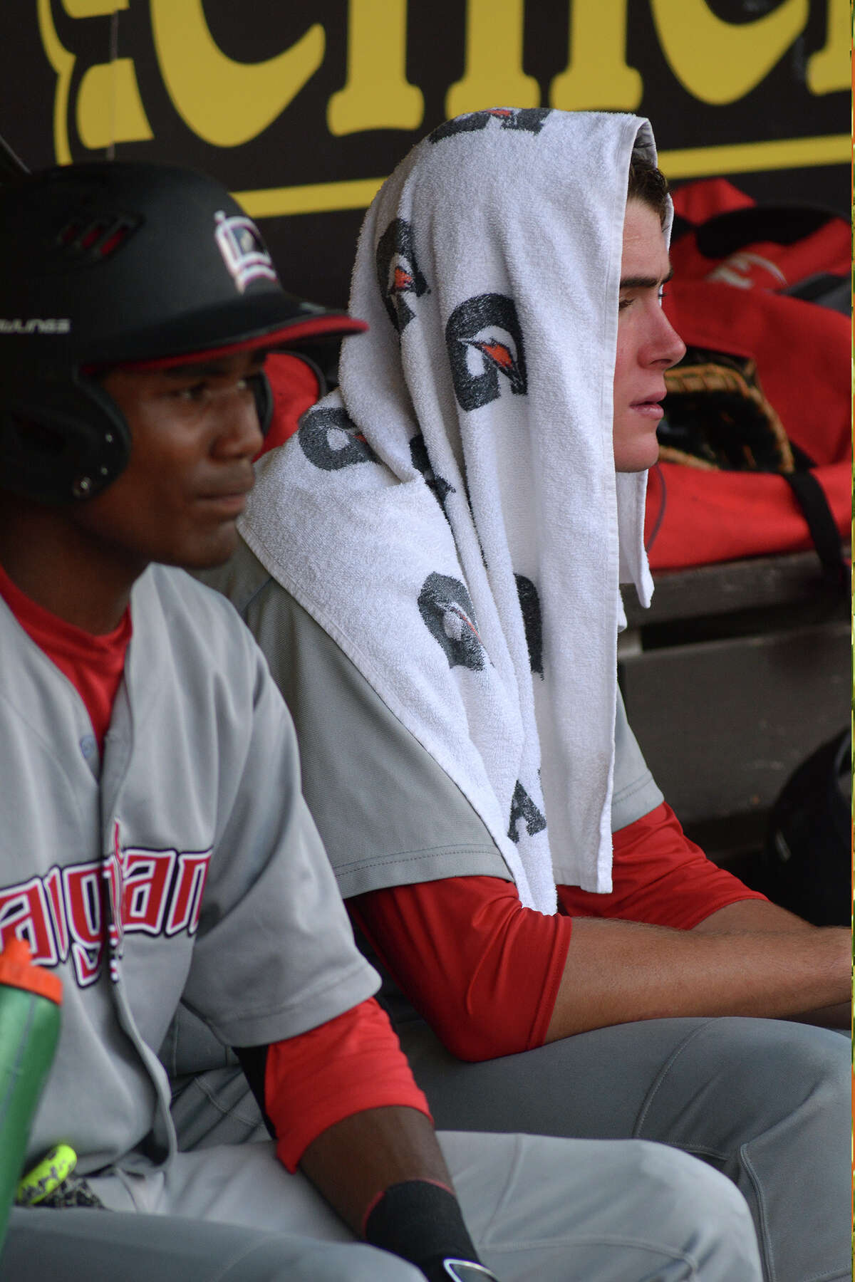 Langham Creek sophomore outfielder and leadoff hitter Korey Holland, left, and senior pitcher Connor Ferguson take a break from the heat during the top of the 5th inning against Dallas Jesuit in their 2016 UIL Baseball State Championships semi-final matchup at Dell Diamond in Round Rock on Friday, June 10, 2016. (Photo by Jerry Baker/Freelance)