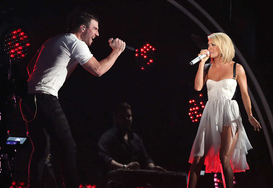 Sam Hunt, left, and Carrie Underwood perform at the 58th annual Grammy Awards on Monday, Feb. 15, 2016, in Los Angeles. (Photo by Matt Sayles/Invision/AP)