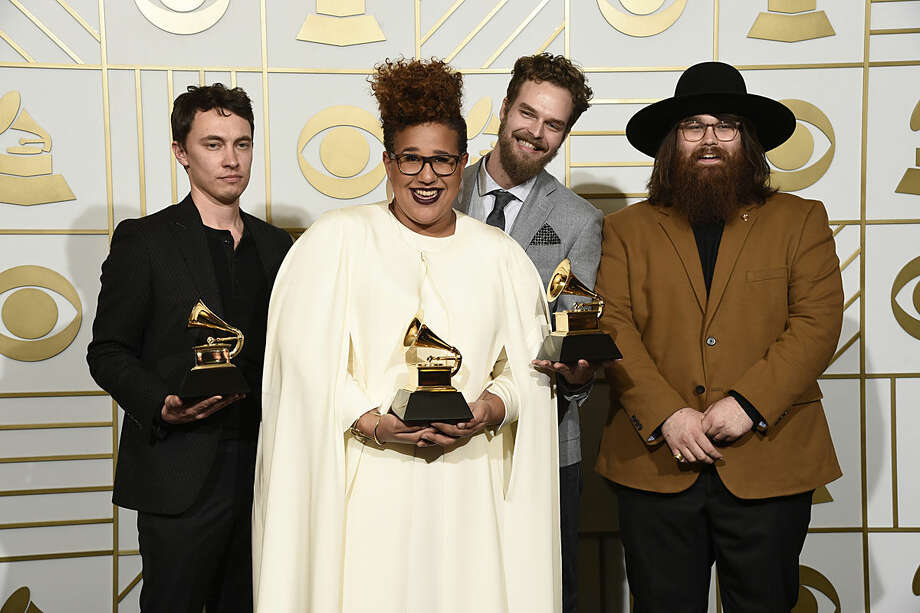 "Heath Fogg, from left, Brittany Howard, Steve Johnson, and Zac Cockrell of Alabama Shakes pose in the press room with the awards for best alternative music album for ""Sound & Color"", best rock song for ""Don't Wanna Fight"", and best rock performance for ""Don't Wanna Fight"" at the 58th annual Grammy Awards at the Staples Center on Monday, Feb. 15, 2016, in Los Angeles. (Photo by Chris Pizzello/Invision/AP)"