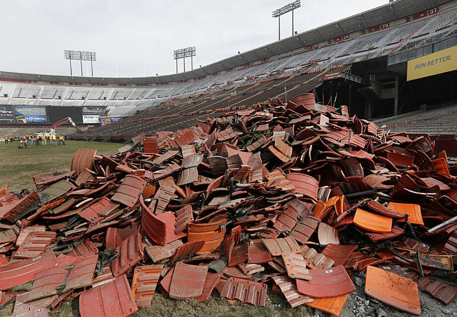 Stadium seats are in a piled on the field as demolition begins on Candlestick Park Wednesday, Feb. 4, 2015, in San Francisco. Crews have started tearing down San Francisco's storied Candlestick Park so houses, a hotel and a shopping center can be built on the site of the former Giants and 49ers stadium. (AP Photo/Ben Margot)