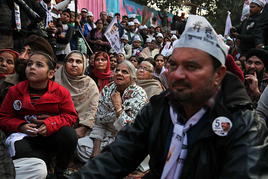 Supporters of Aam Aadmi Party, or Common Man Party, listen to their leader Arvind Kejriwal during an election campaign rally for the upcoming Delhi elections in New Delhi, India, Wednesday, Feb. 4, 2015. Delhi will go to the polls on Feb. 7. (AP Photo/Altaf Qadri)