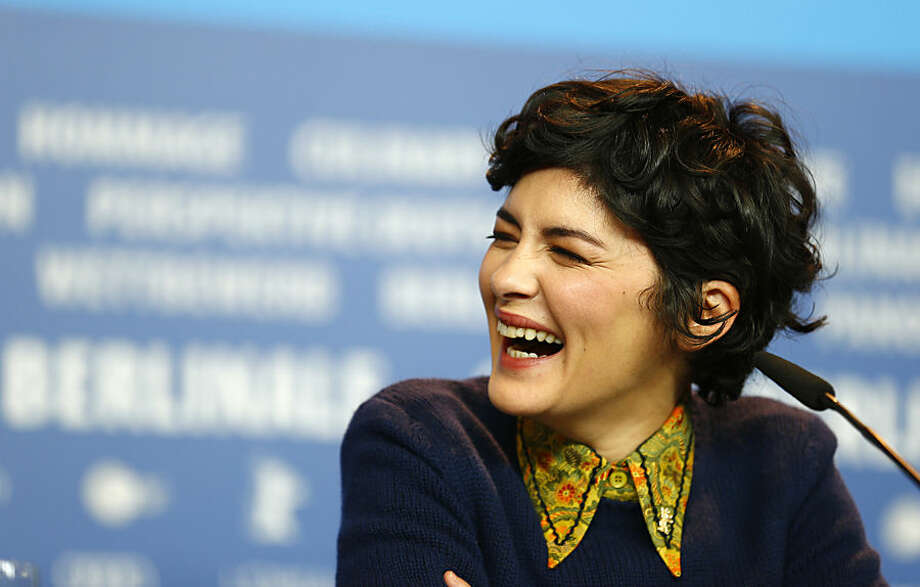 French actress Audrey Tautou laughs during the jury press conference at the 2015 Berlinale Film Festival in Berlin Thursday, Feb. 5, 2015. (AP Photo/Axel Schmidt)