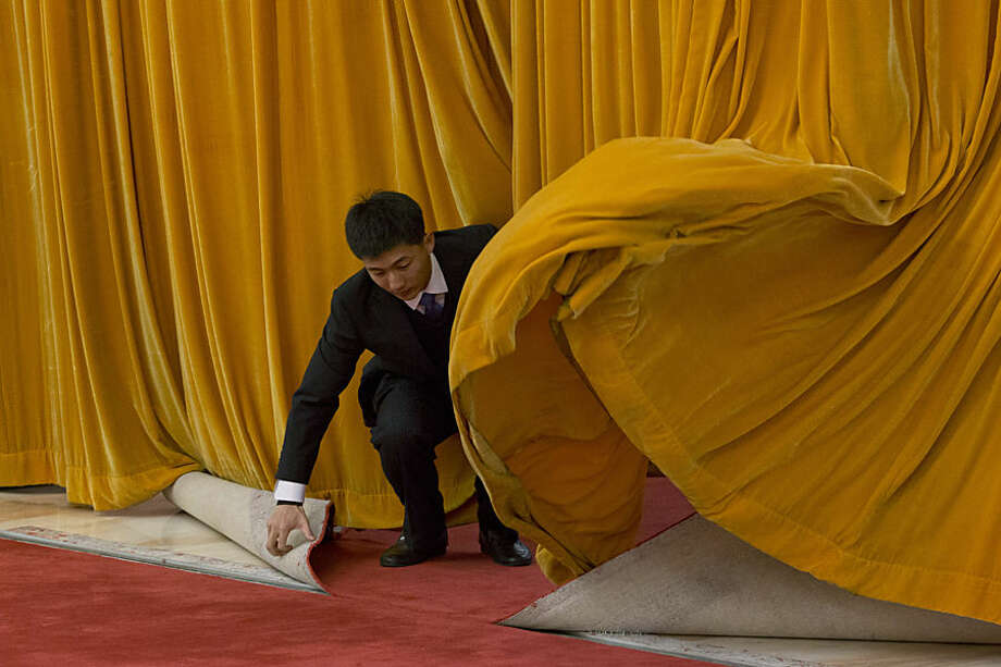A worker at the Great Hall of the People prepares for the welcome ceremony for Argentinian President Cristina Fernandez in Beijing Wednesday, Feb. 4, 2015. (AP Photo/Ng Han Guan)