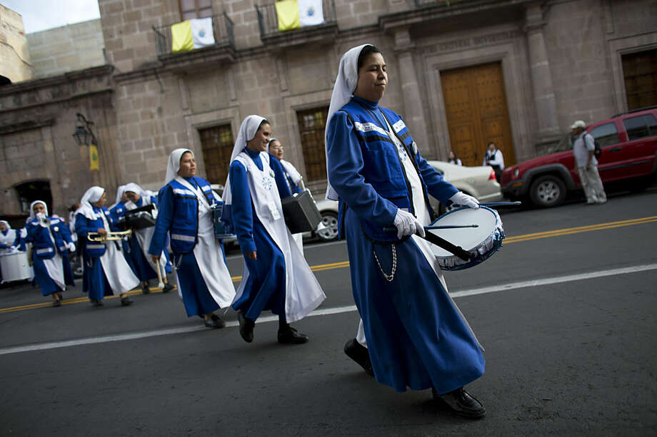 A marching band of nuns, from Monterrey, play their instruments as they spontaneously parade on the eve of Pope Francis' arrival, in Morelia, in the Mexican state of Michoacan, Monday, Feb. 15, 2016. On his one-day trip to the capital Morelia, Francis will visit the cathedral, meet with youth, and celebrate Mass with priests and seminarians, and religious men and women. (AP Photo/Rebecca Blackwell)