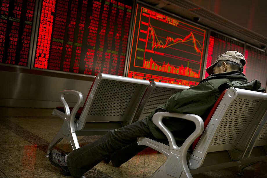 A Chinese investor naps in front of electronic displays at a brokerage house in Beijing, Tuesday, Feb. 16, 2016. Asian stocks rose for a second day Tuesday as a strengthening yuan and hopes for more central bank stimulus gave investors relief from the mauling that markets have suffered so far this year. (AP Photo/Mark Schiefelbein)