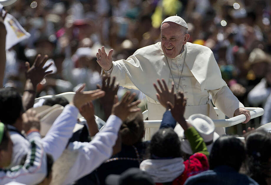 Pope Francis waves to the crowd as he leaves after celebrating Mass in San Cristobal de las Casas, Mexico, Monday, Feb. 15, 2016. Francis is celebrating Mexico's Indians on Monday with a visit to Chiapas state, a center of indigenous culture, where he will preside over a Mass in three native languages thanks to a new Vatican decree approving their use in liturgy. The visit is also aimed at boosting the faith in the least Catholic state in Mexico. (AP Photo/Eduardo Verdugo)