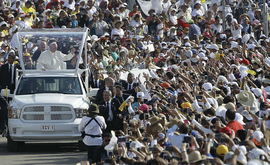 Pope Francis arrives in the popemobile to Viktor Manuel Reyna stadium, in Tuxtla Gutierrez, Mexico, Monday, Feb. 15, 2016. Francis is celebrating Mexico's Indians on Monday with a visit to Chiapas state, a center of indigenous culture, where he presided over a Mass in three native languages thanks to a new Vatican decree approving their use in liturgy. The visit is also aimed at boosting the faith in the least Catholic state in Mexico. (AP Photo/Gregorio Borgia)