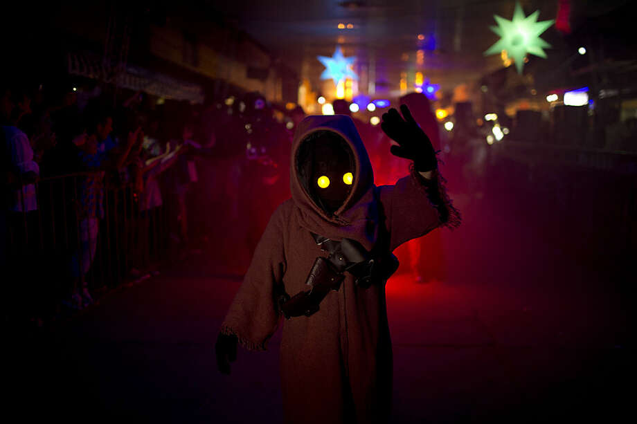 In this Feb. 14, 2016 photo, a youth sporting a Star Wars costume parades at the annual Alien Festival in Capilla del Monte, Cordoba, Argentina, the site of an alleged UFO sighting 30 years ago. Thousands of earthlings gathered for the festival in this central Argentine town which has become a global hot spot for UFO sightings. (AP Photo/Natacha Pisarenko)