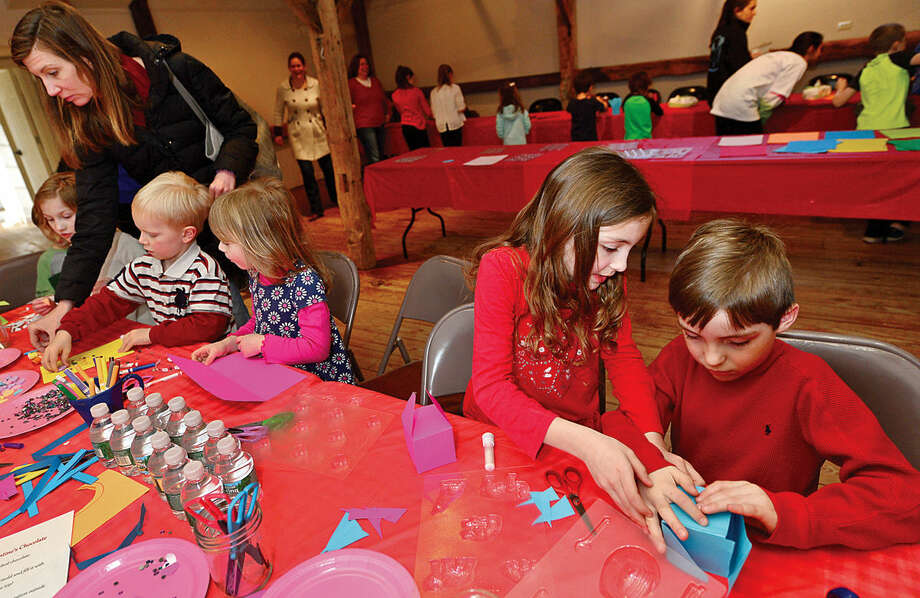 Hour photo / Erik Trautmann Wilton Historical Society held their 3rd annual Valentine Chocolate-Making Workshop for kids in grades kindergarten through 8 Thursday. Program participants also made Valentines cards box to put the chocolates in. The one-hour session made use of an extensive collection of small, charming chocolate mold featuring hearts, a multitude of animals, and stars.