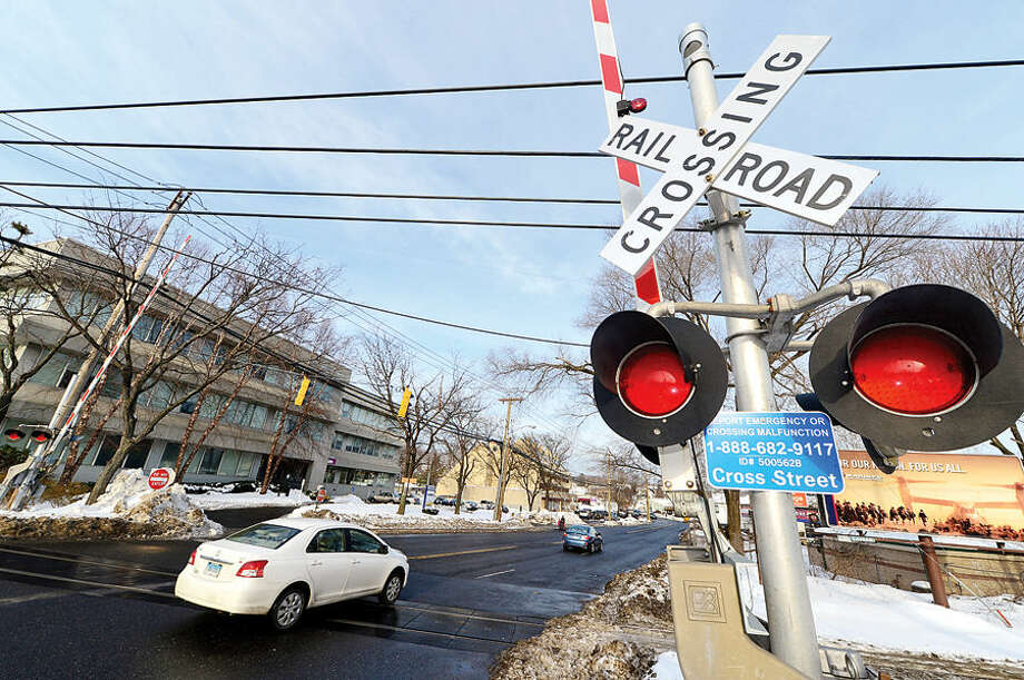 Hour photo / Erik Trautmann Railroad crossing at Cross St (Route 1) on the Danbury Line in Norwalk. Does Metro-North Railroad have safety measures in place along Danbury and New Canaan lines to prevent accidents at crossings like the one that ocurred Tuesday in Valhalla, NY?