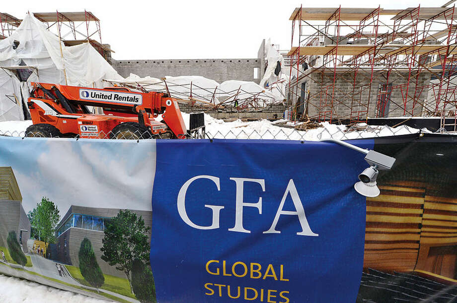 Hour photo / Erik Trautmann A cobstruction scaffolding at Green Farms Academy in Westport collapsed Thursday sending four to the hospital.