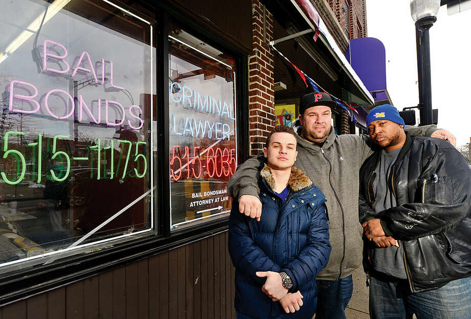 Hour photo / Erik Trautmann Bail King owner Chris DeRoja, center, and his bail bondsmen, Chris Tarzia and David Lewis, weigh in on Connecticut Governor Dannel Malloy's proposed bail reforms