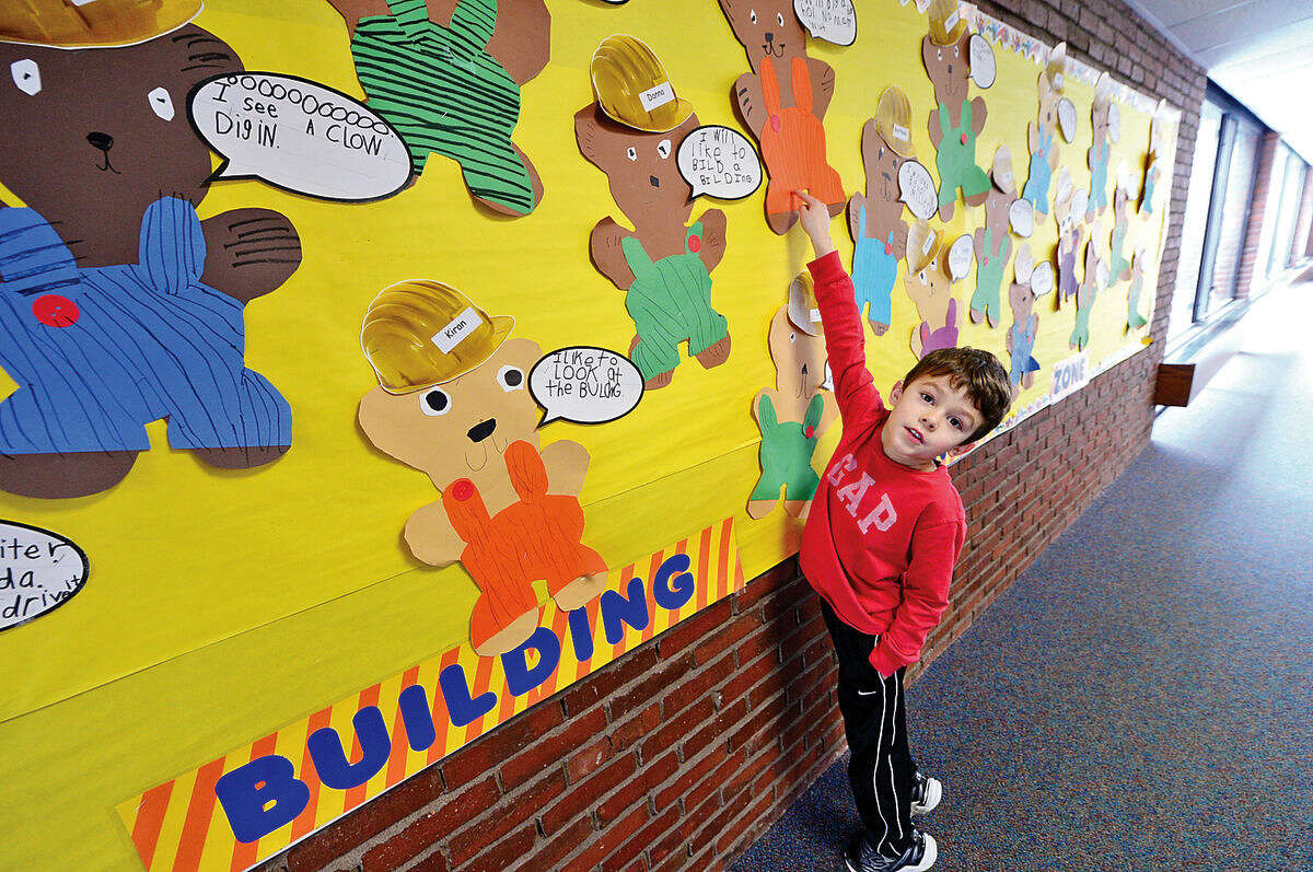 Miller-Driscoll School kindergartner Bryan Ennis and his classmates made crafts expressing what they thought of the ongoing construction and renovation at the school.
