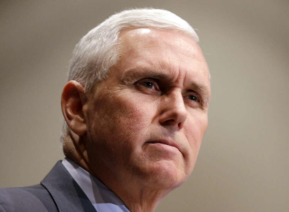 """FILE - In this Jan. 27, 2015 file photo, Indiana Gov. Mike Pence pauses while speaking in Indianapolis. As they begin to shape their prospective bids for president, a group of ambitious Republican governors are eager to seize on voters' contempt for that most dirty of political words: """"Washington."""" (AP Photo/Michael Conroy, File)"""