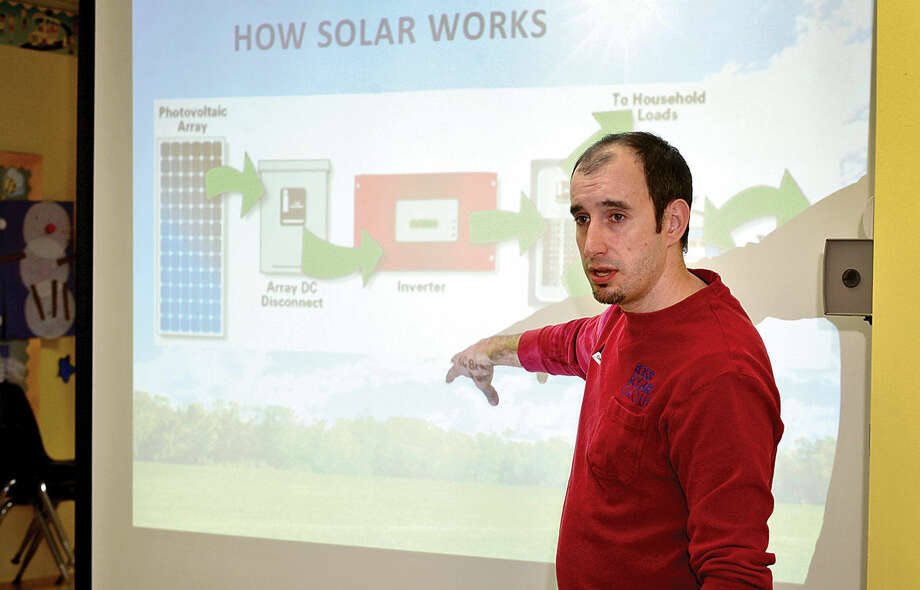 Ross Solar Group representative, Stephan Hartmann, talks to local residents about the state and town sponsored solar program, Solarize Wilton, which offers discounts and energy savings that come with installing solar through the program.