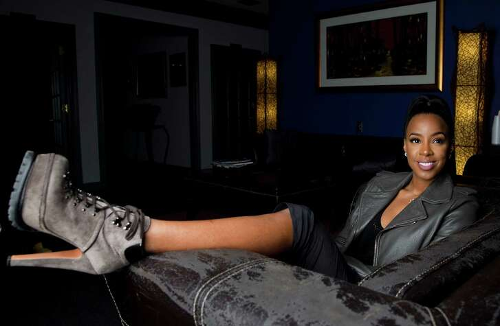 """In this Dec. 3, 2015 photo, recording artist Kelly Rowland, formerly of Destiny's Child, poses for a portrait in Atlanta. Rowland is recording a solo album and filming a documentary series called """"Chasing Destiny,"""" which premieres on BET in April. (AP Photo/John Bazemore)"""