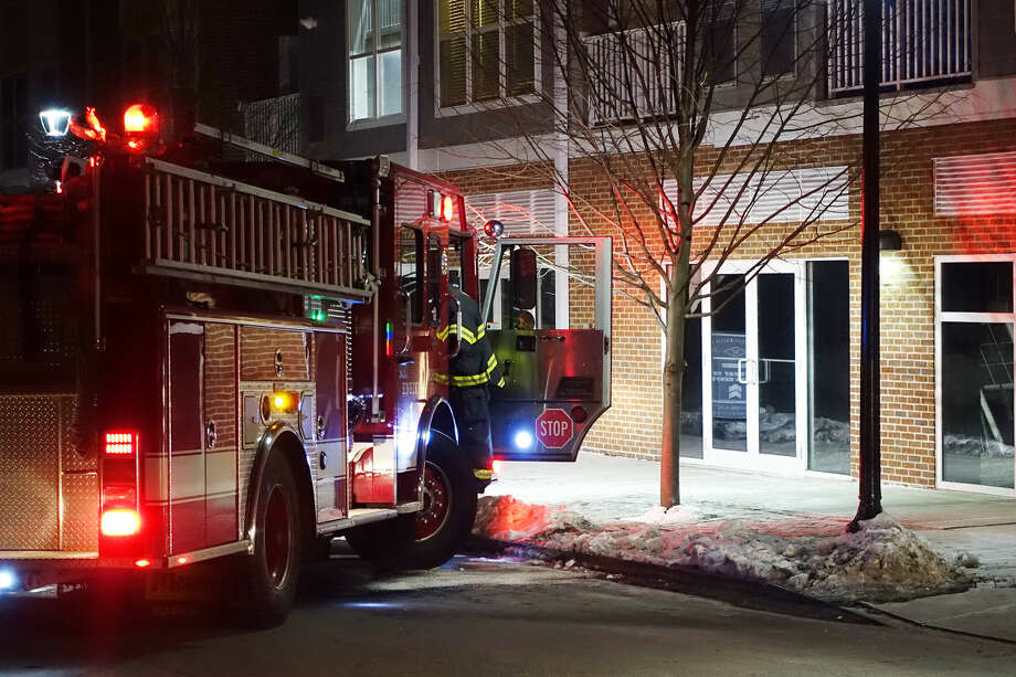 Hour photo/Jeff Dale Norwalk Fire Department evacuated the Waypointe Apartments, 515 West Ave., Norwalk, after a gas leak on Merwin Street Friday night.