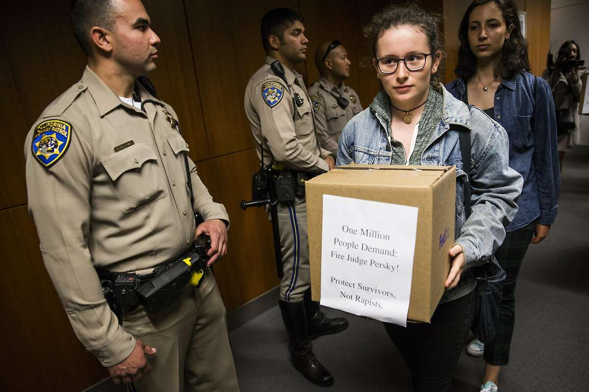 Darya, a high school student who requested not to give her last name, helps deliver boxes representing nearly one million signatures signed demanding the removal of Judge Aaron Persky to California Commission on Judicial Performance at the State of California Building in San Francisco, CA on June 10, 2016. Darya says she signed the petition and came down to the state building to watch the signatures be delivered. Judge Persky has come under fire for giving what many consider a lenient sentence to Brock Turner, a convicted rapist.