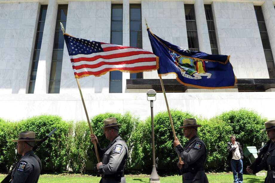 The New York State Police and Department of Corrections Color Guard process during the New York State Crime Victims' Memorial Ceremony at the Empire State Plaza on Friday June 10, 2016 in Albany, N.Y. (Michael P. Farrell/Times Union) Photo: Michael P. Farrell / 40036934A