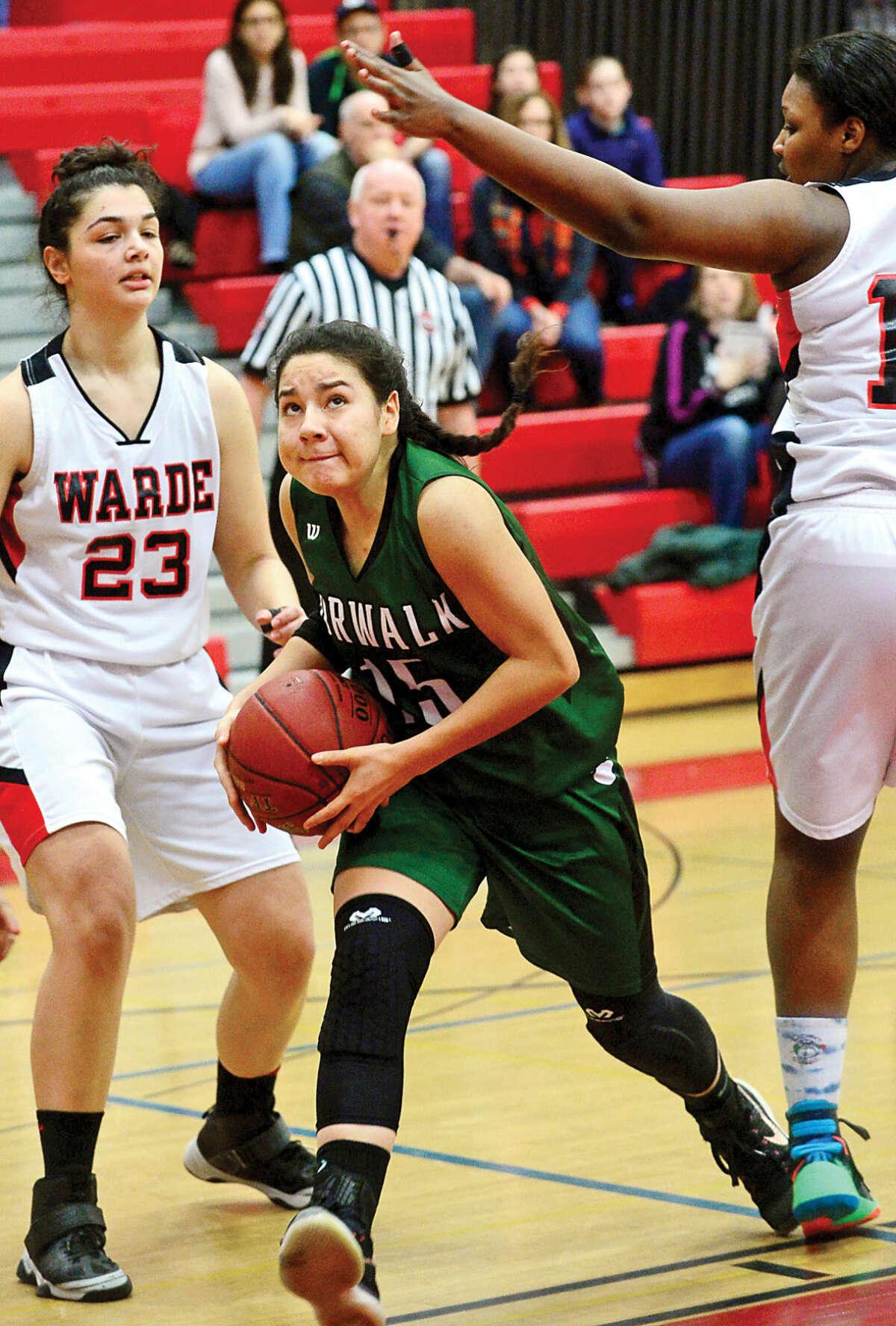 Hour photo / Erik Trautmann Norwalk High School Girls Basketball player #15 Tatiana Arias goes up for the shot against Fairifeld Warde in the FCIAC quarter finals Saturday in Fairfield.