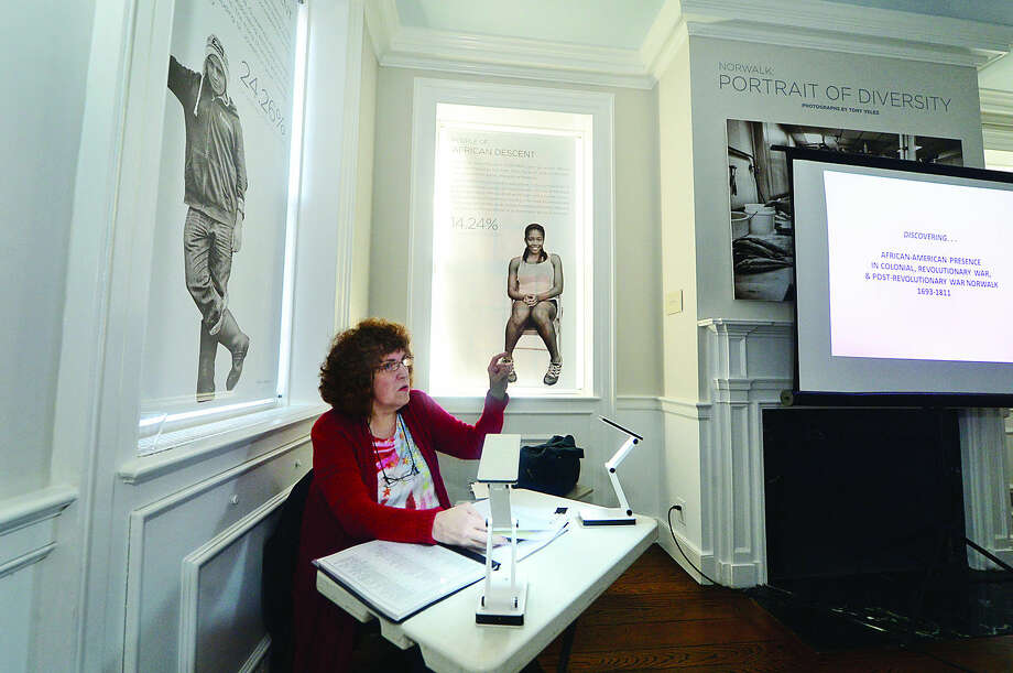 Hour photo / Erik Trautmann Historian Madeline Eckhert holds a slide lecture about the earliest afro-americans in Norwalk Saturday at the Norwalk Historical Society in honor of Black History Month,