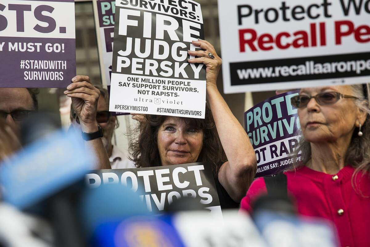 A woman attends a press conference held before the delivery of nearly one million signatures demanding the removal of Judge Aaron Persky to California Commission on Judicial Performance at the State of California Building in San Francisco, CA on June 10, 2016. Judge Persky has come under fire for giving what many consider a lenient sentence to Brock Turner, a convicted rapist.