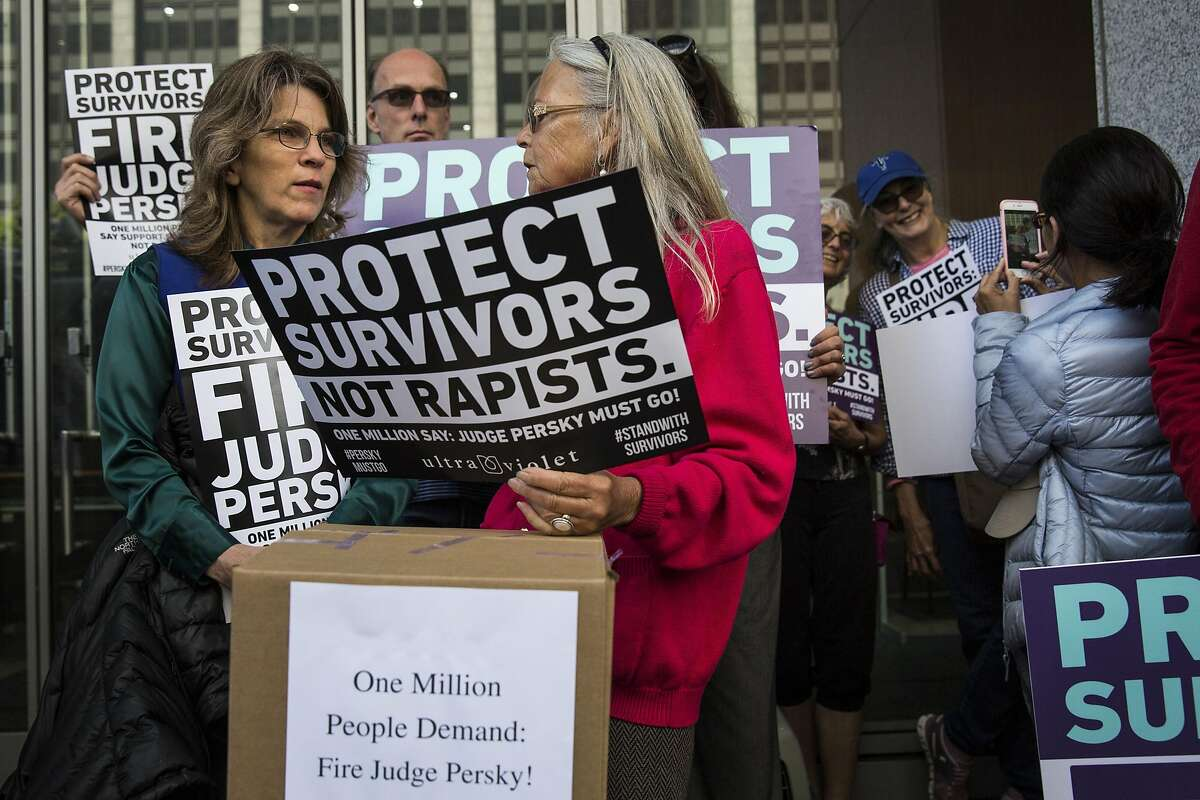 Mary Jean Koontz (L), a woman who identifies as a business woman, professor and victim of rape when she was younger, and Deborah Atkins (C), participate in a press conference held before the delivery of nearly one million signatures demanding the removal of Judge Aaron Persky to California Commission on Judicial Performance at the State of California Building in San Francisco, CA on June 10, 2016. Judge Persky has come under fire for giving what many consider a lenient sentence to Brock Turner, a convicted rapist.