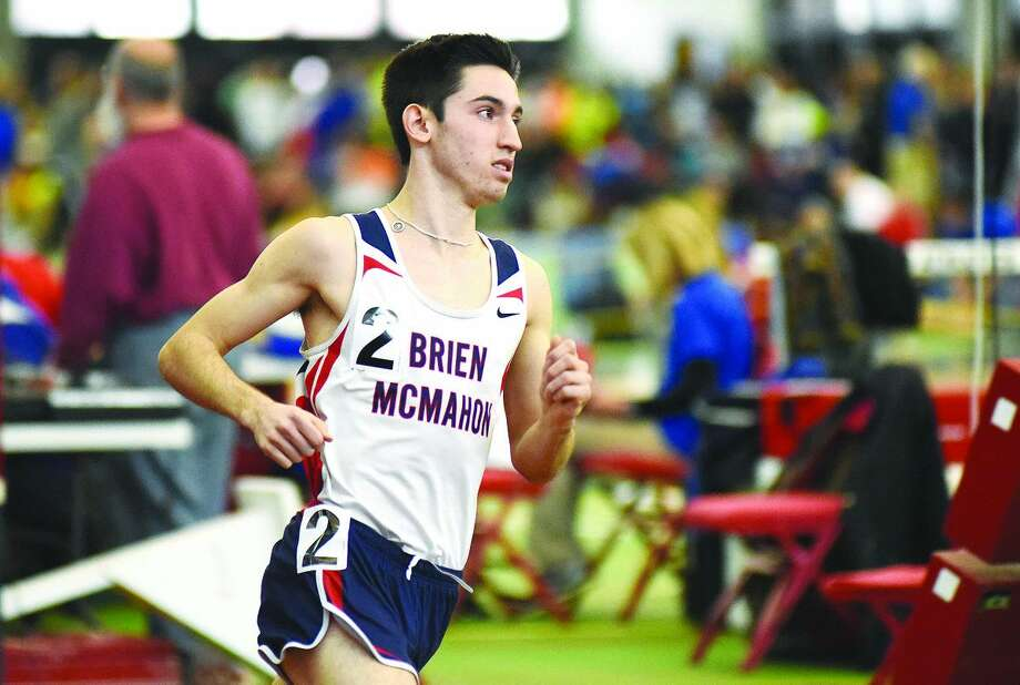 Hour photo/John Nash - Eric van der Els of Brien McMahon pulled off a rare distance triple at Saturday's CIAC State Open track meet, winning the 1,000, the 1,600 and 3,200 and helping the Senators place second to unofficial winner Danbury.