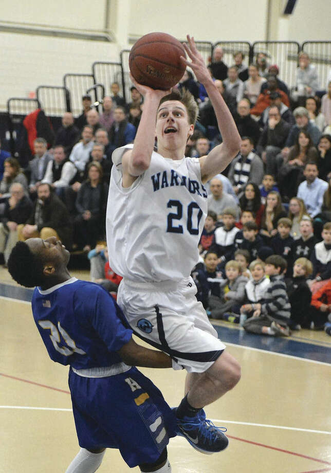 Hour photo/Alex von KleydorffWilton's Michael Bingman (20) puts up a shot against Harding on Friday.