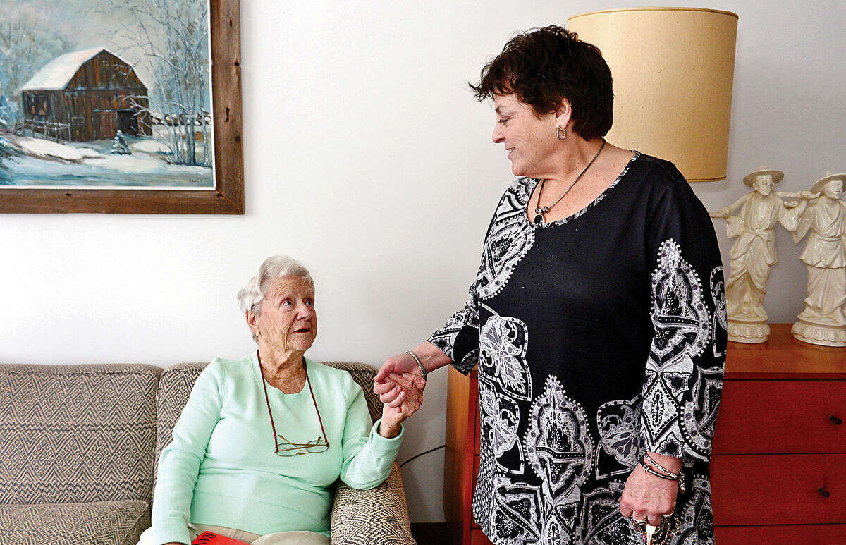 Hour photo / Erik Trautmann Resident Rith Court chats with Mary Windt who is celebrating 20 years as the Executive Director of Under One Roof and The Marvin senior housing facility.