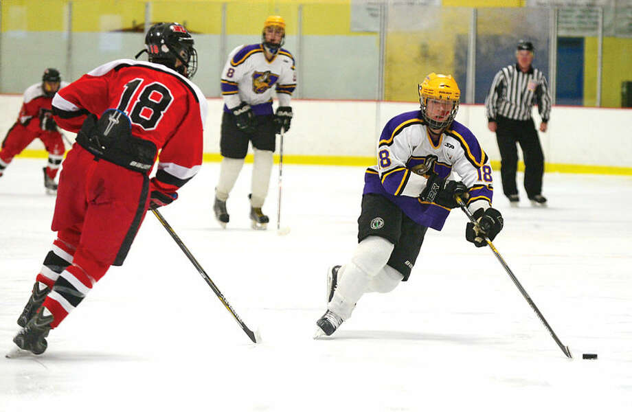 Hour photo / Erik Trautmann Westhill High School co op hockey team takes on Farfield Warde in their regular season FCIAC game Saturday at Terry Connors Rink in Stamford.