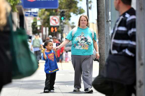 Angela Stephens walks with her son, Walter Hayes, in the Mission District on June 10, 2016.