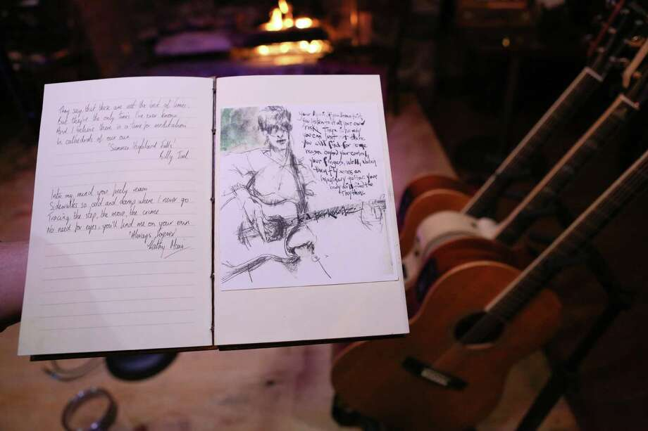 Once every few weeks, musician Kathy Muir, of Stamford, brings together a few musicians from across Connecticut, interviews them and has them put quotes from a favorite song or two in a sketchbook. As they play live, a sketch artist sketches them into the book, as shown. Photo: Bradley E. Clift /For Hearst Connecticut Media / All images produced are owned by Bradley E. Clift  © 2016  Any use beyond Hearst  must have written permission from copyright ho