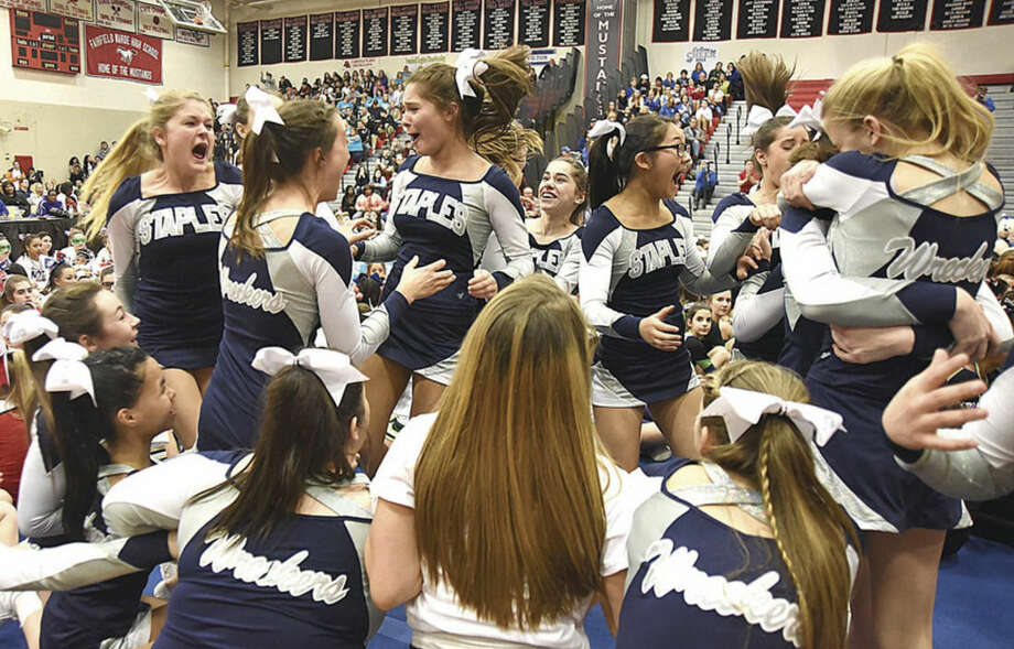 Hour photo/John NashThe Staples High School cheerleading team explodes into a frenzy as they were announced as runners-up during Saturday's FCIAC cheerleading championship competition at Fairfield Warde High School.