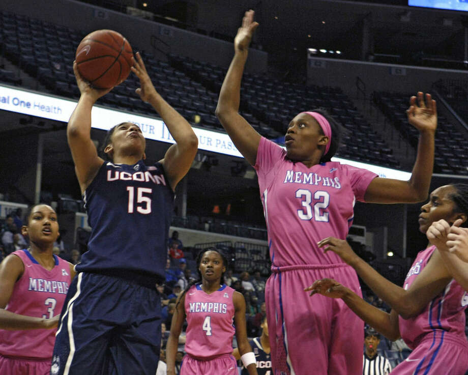 Connecticut's Gabby Williams (15) shoots a basket while being guarded by Memphis' Courtney Powell (32) in the second half of an NCAA college basketball game Saturday, Feb. 7, 2015, in Memphis, Tenn. (AP Photo/Karen Pulfer Focht)