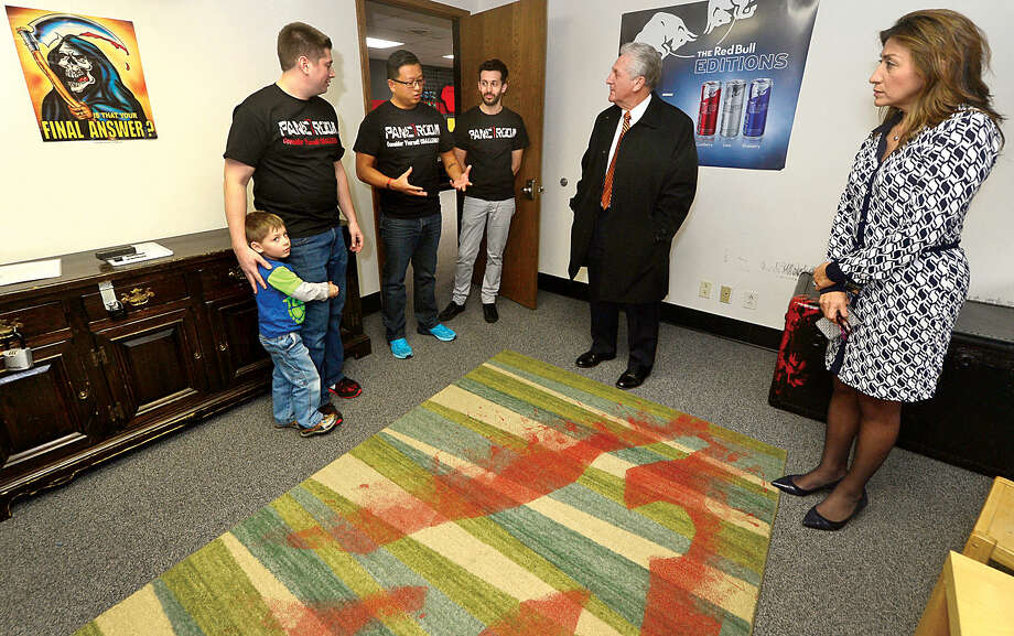 Hour photo / Erik Trautmann Panic Room founders, Justin Buturla, with his son Justin jr, Jack Yeung and Filipe Silva chat with Norwalk Mayor Harry Rilling and his wife, Lucia, during the mayor's small busniess spotlight visit.