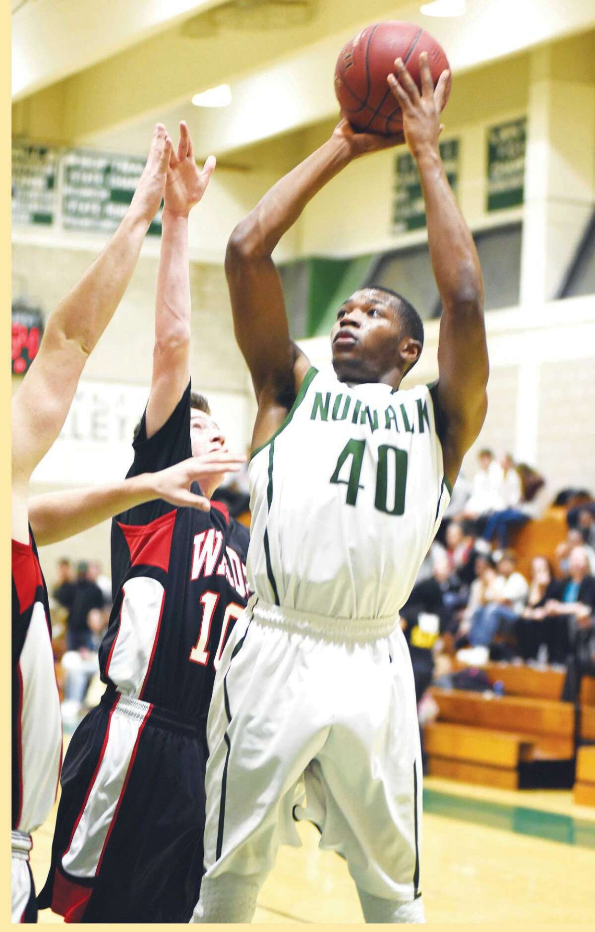 Hour photo/John Nash - Norwalk's Jakari Gainer (40) puts up a shot during Tuesday's game against Fairfield Warde.