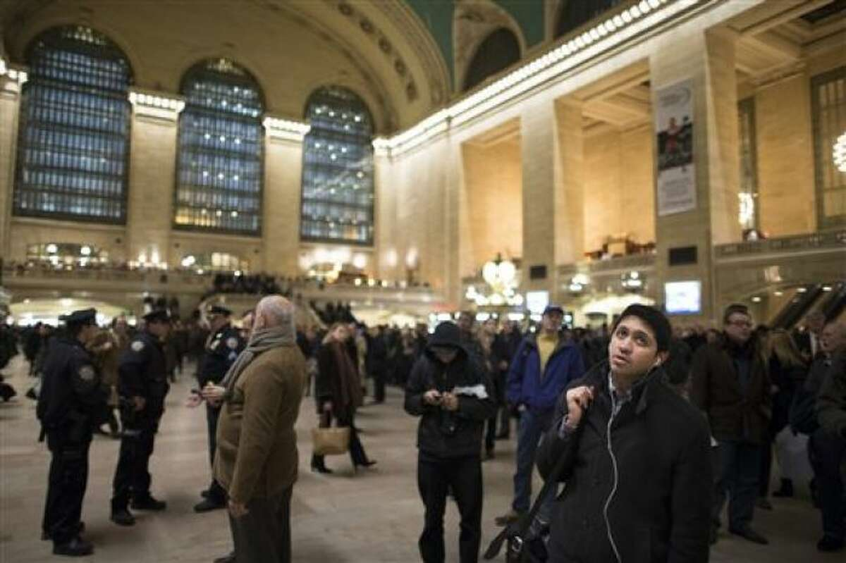 Hundreds of commuters pack the main hall of Grand Central Station after a power problem with Metro-North Railroad's computer system caused the suspension of service on the Hudson, Harlem, and New Haven lines, Thursday, Jan. 23, 2014, in New York. Trains were brought to a halt for safety purposes while electricians worked to hook up temporary power to the computer system. Metro-North is the nation's second-busiest railroad and serves 281,000 riders a day in New York and Connecticut. (