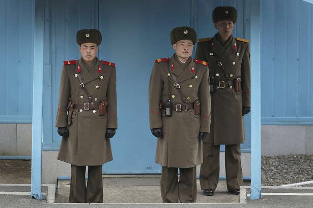 North Korean soldiers guard the truce village of Panmunjom at the Demilitarized Zone (DMZ) which separates the two Koreas on Monday, Feb. 22, 2016, in Panmunjom, North Korea. Though the world's most fortified border can often seem like a tourist trap, drawing throngs of camera-happy visitors on both sides every year, to the military-trained eye the Cold War style standoff along the DMZ is an incident waiting to happen. And with tensions between Seoul, Pyongyang and Washington, this is one of those times when that's more true than ever. (AP Photo/Wong Maye-E)