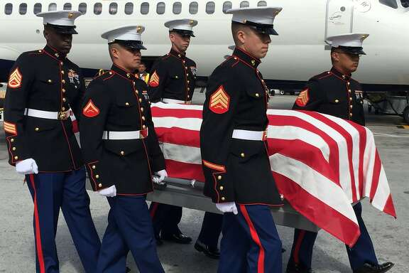 Marines carry a casket containing the remains of Pfc. John Saini of Healdsburg, who was killed in the Pacific theater during World War II.