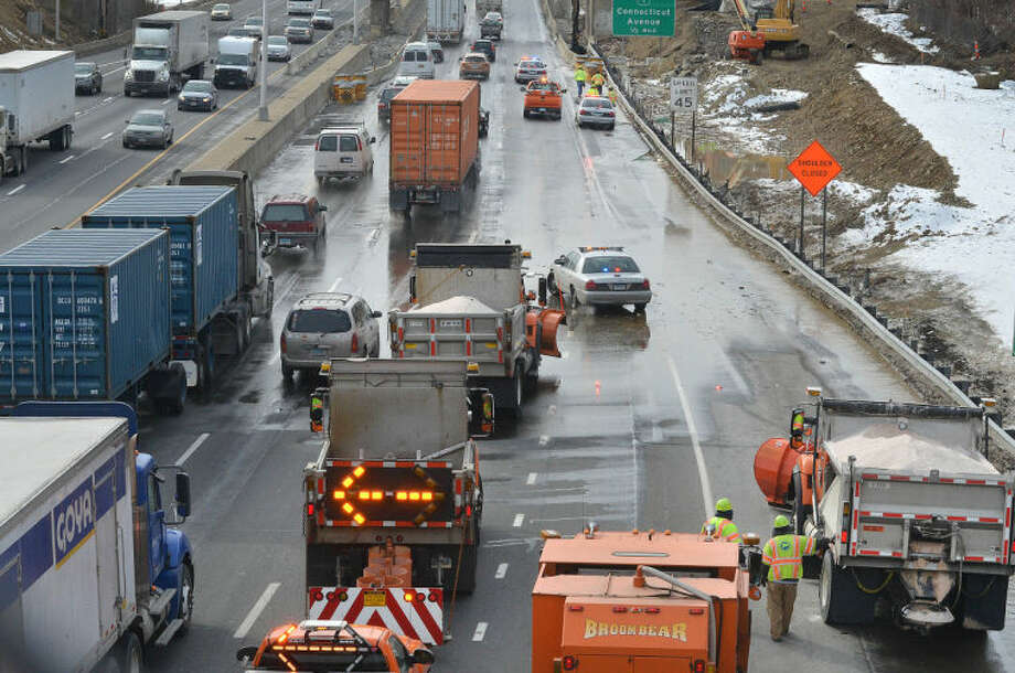 Hour Photo/Alex von Kleydorff. Traffic southbound near exit 15 snakes around a flooded roadway where a water main broke on to the highway at about 1pm on Tuesday