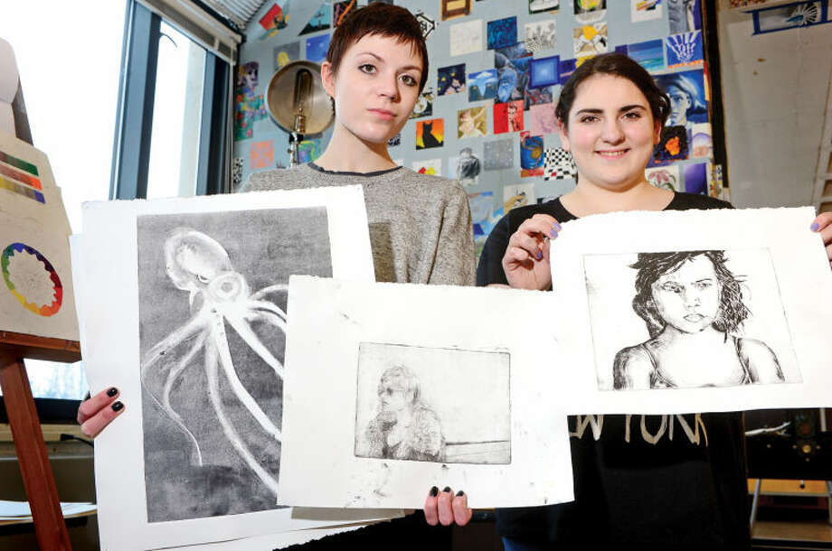 Hour photo / Erik Trautmann Norwalk High School students Rachel Welch and Catherine Robinson were winners in the Connecticut Scholastic Art Awards competition.