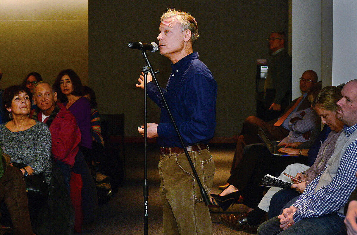Stamford resident Tom Agoston asks a question about mounting federal debt as Congressman Jim Himes holds a town hall-style meeting at the University of Connecticut's Stamford campus Saturday afternoon.
